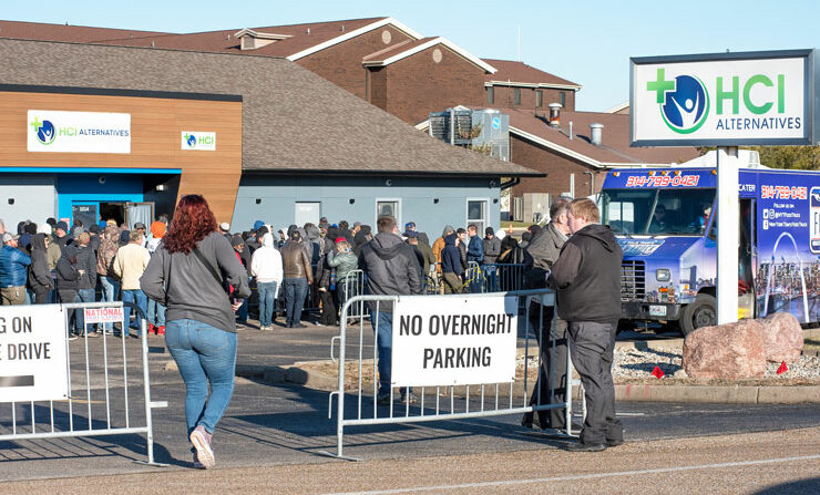 Hundreds line up outside a marijuana dispensary in Illinois