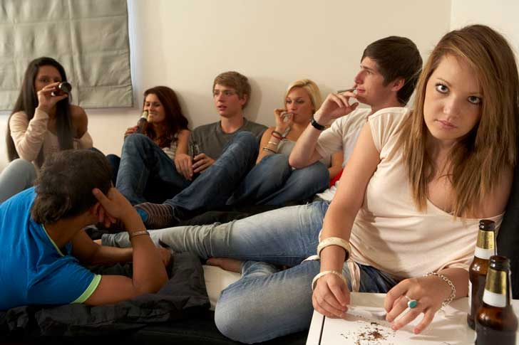 A group of young people smoking cannabis
