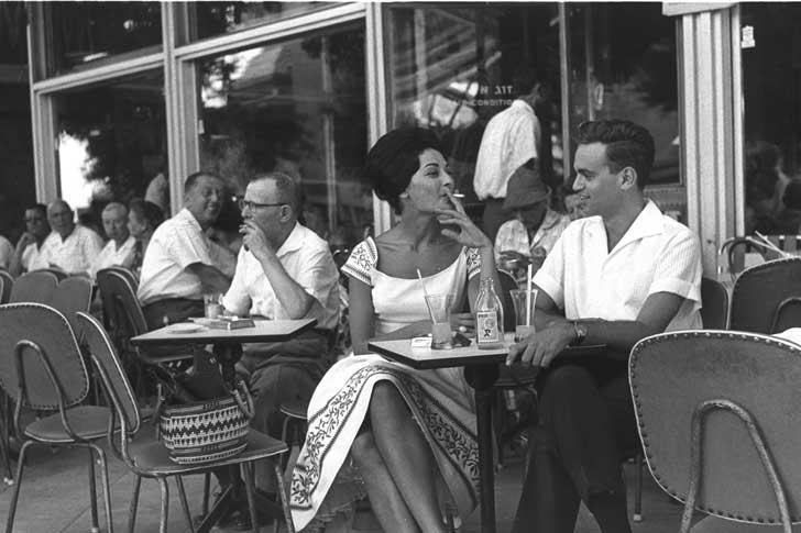 Israelis smoking at a sidewalk cafe in Tel Aviv